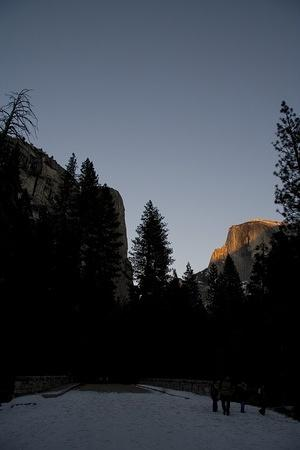 The top of Half Dome glows with the last light of the day