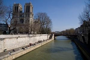 Crowds outside Notre Dame and along the Seine river